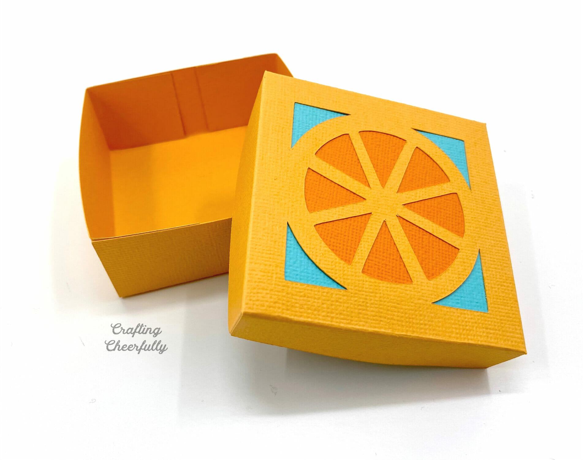 Orange tutti frutti party favor box.