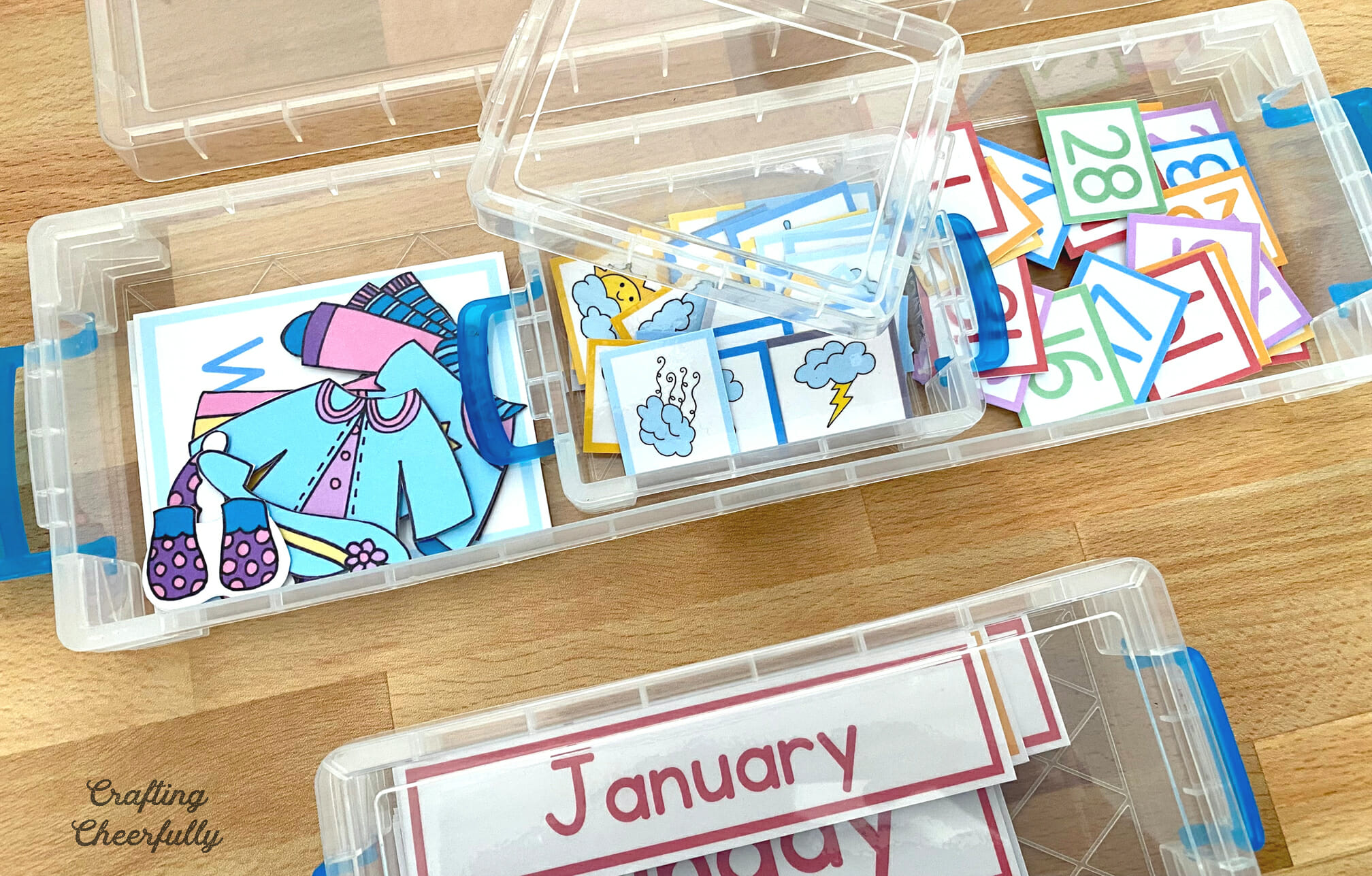 Storage container for small calendar pieces.