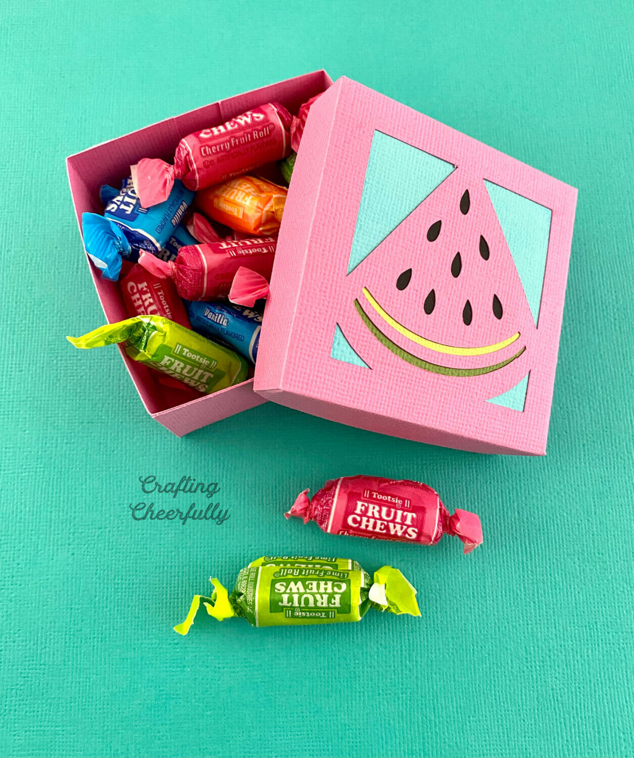 Watermelon fruit box filled with candy.