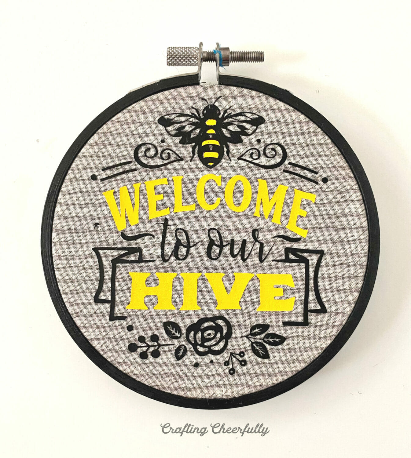 Embroidery hoop with bee image applied to the fabric.