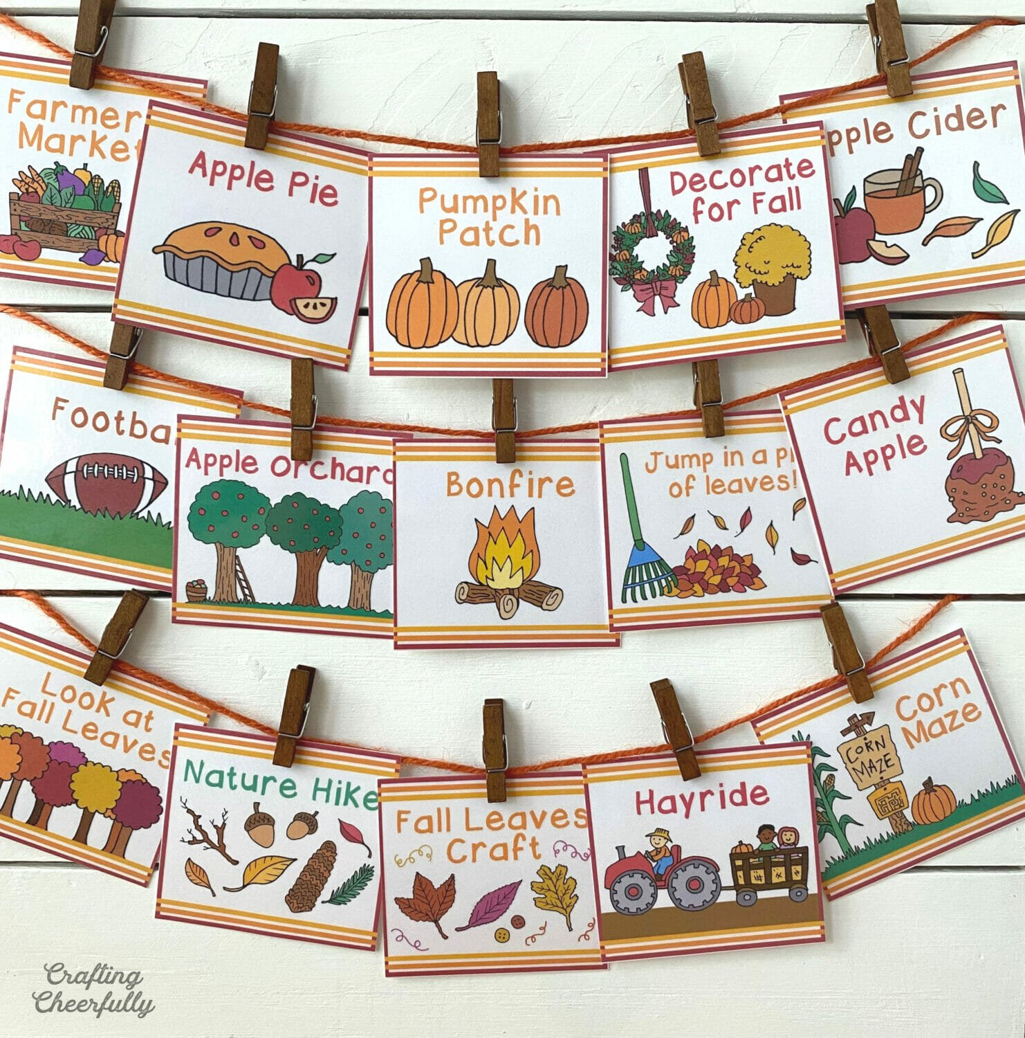 Fall bucket list activity cards clipped to a board.