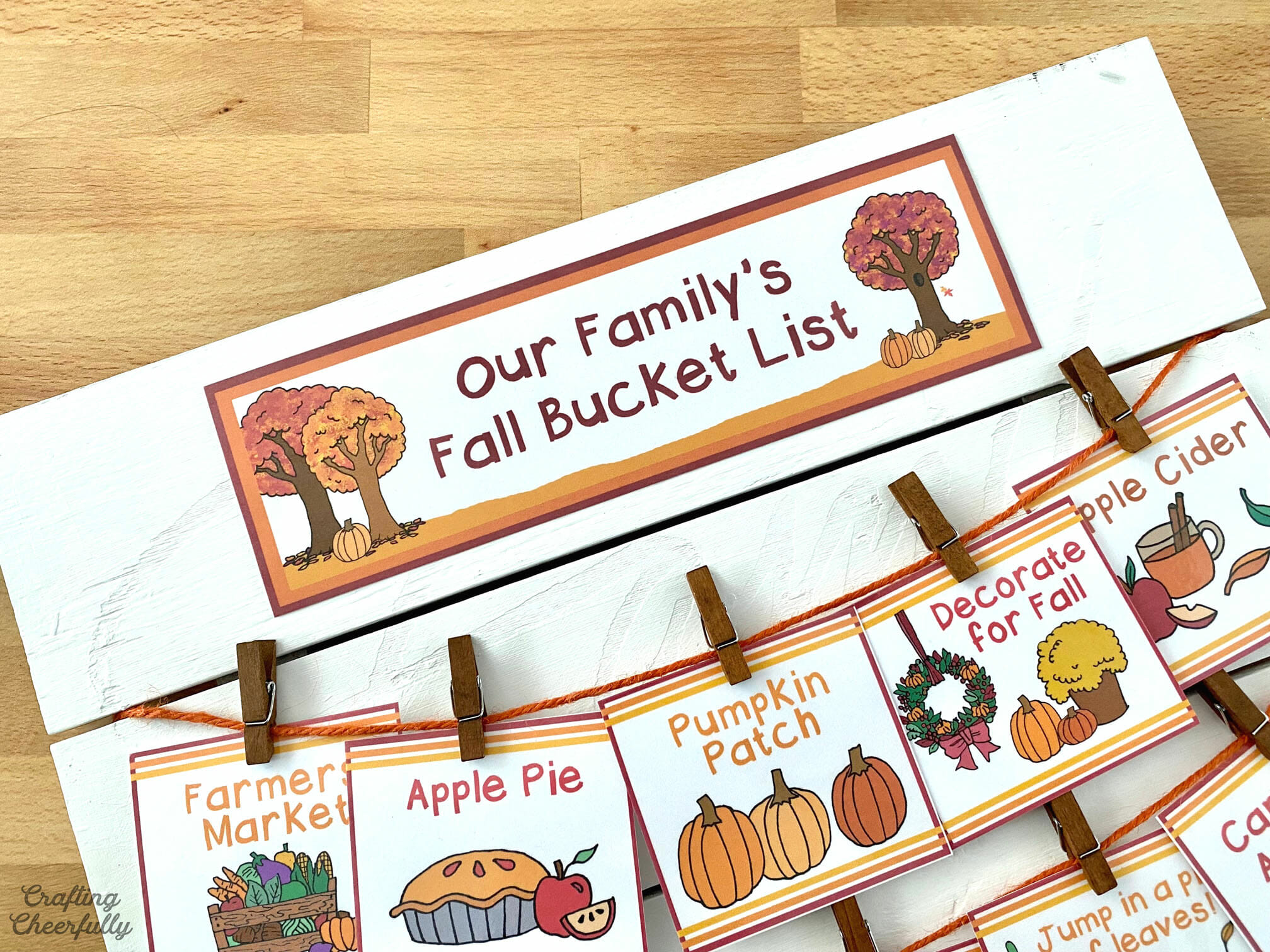 """Close up picture of the label at the top of the fall bucket list board that reads """"Our Family's Fall Bucket List""""."""