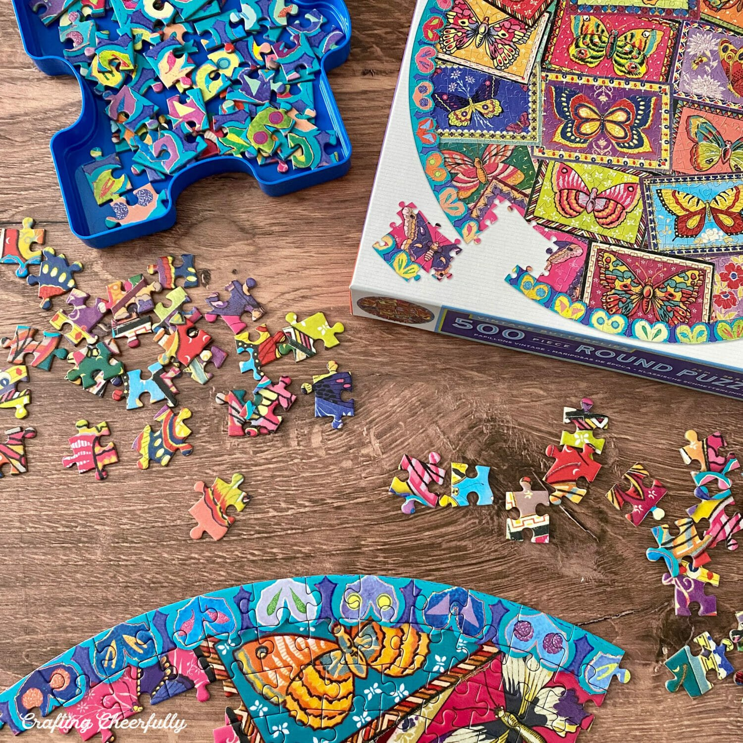 Overhead pictures of a puzzle being assembled on a wooden table.