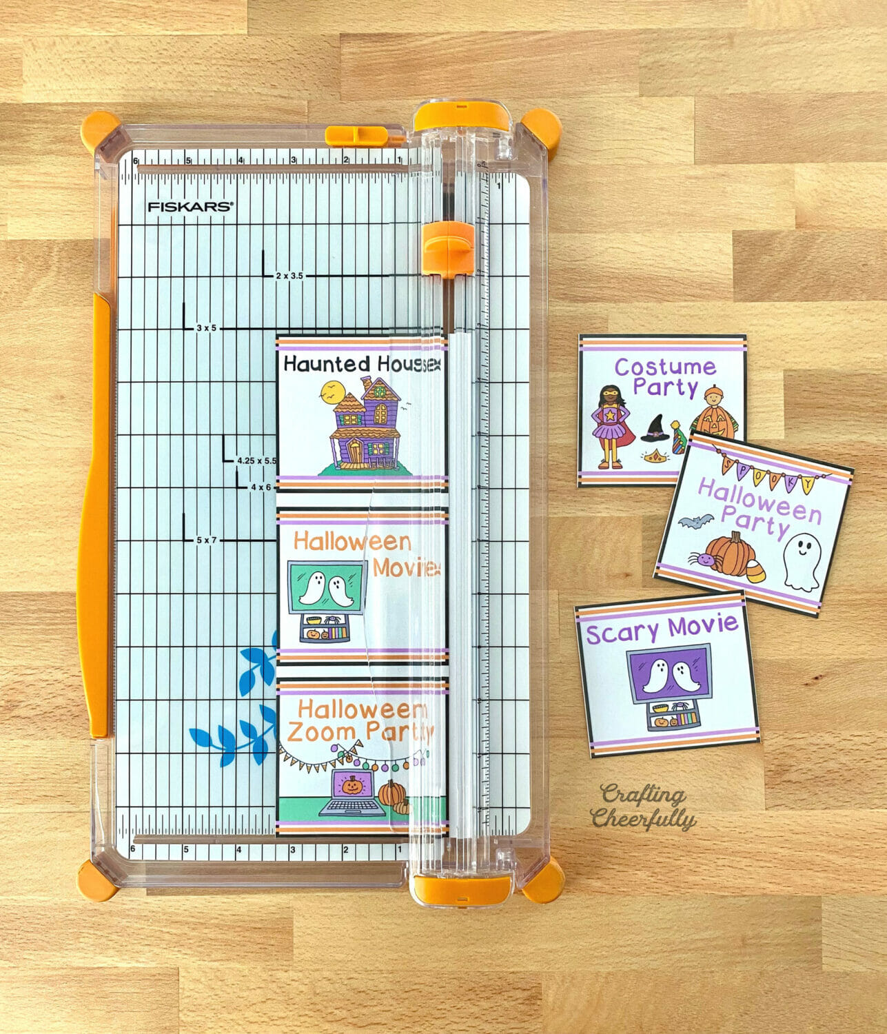 Halloween bucket list cards are cut using a paper timmer.