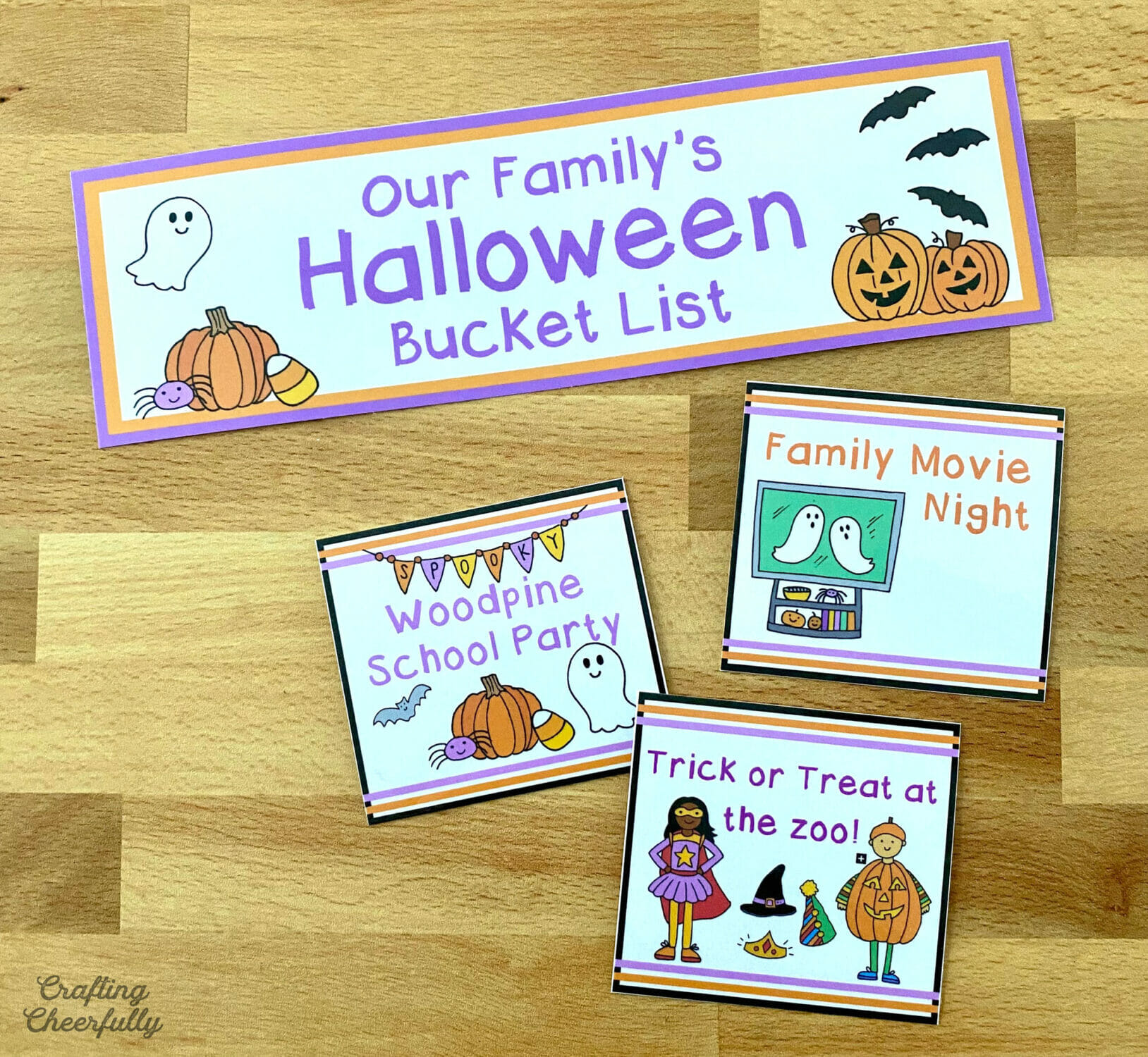 Personalize Halloween bucket list cards lay on a table top.