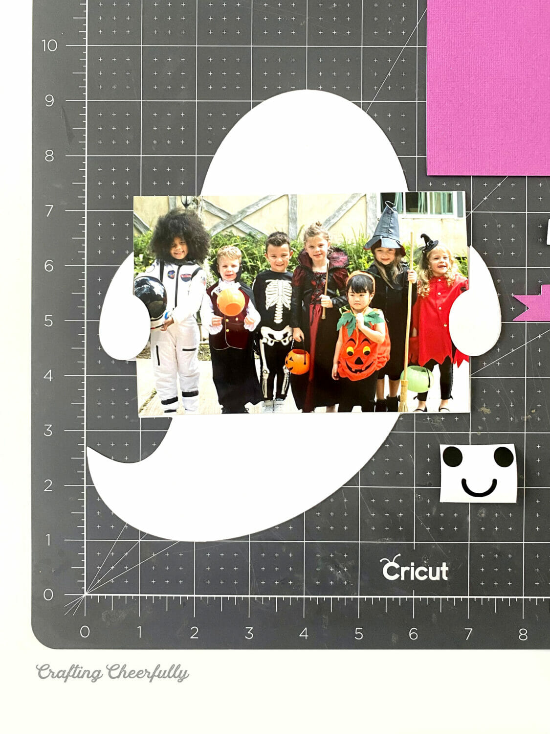 Ghost Paper Banner with picture of kids in costumes.