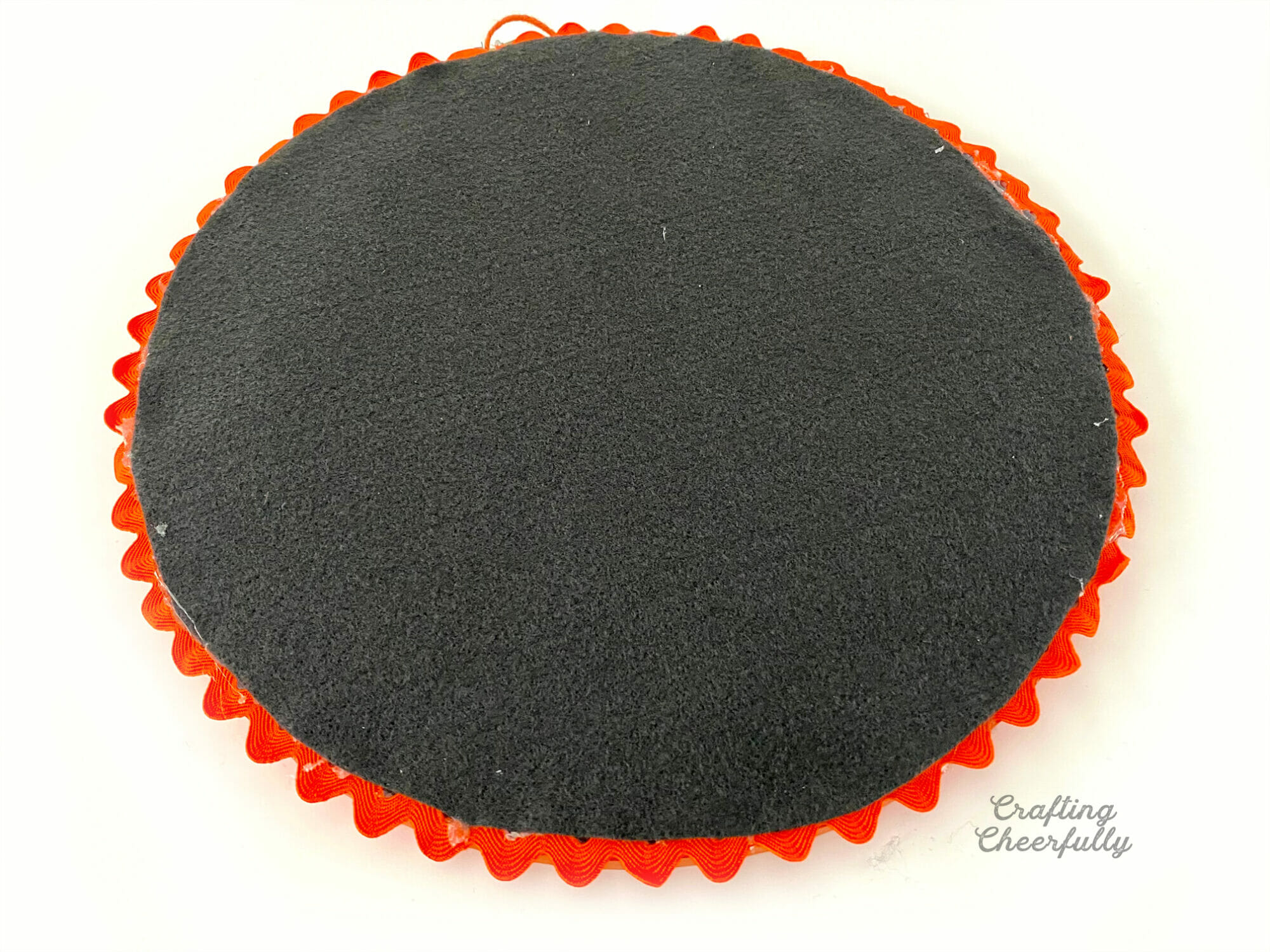 Back of embroidery hoop covered with black felt.