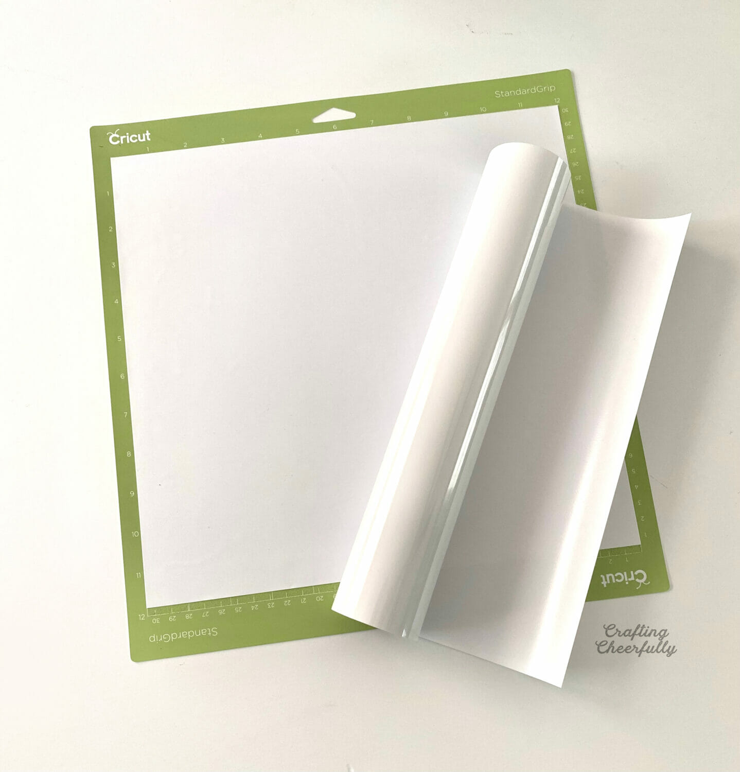 A large piece of glow in the dark heat transfer vinyl is applied to a Cricut cutting mat.