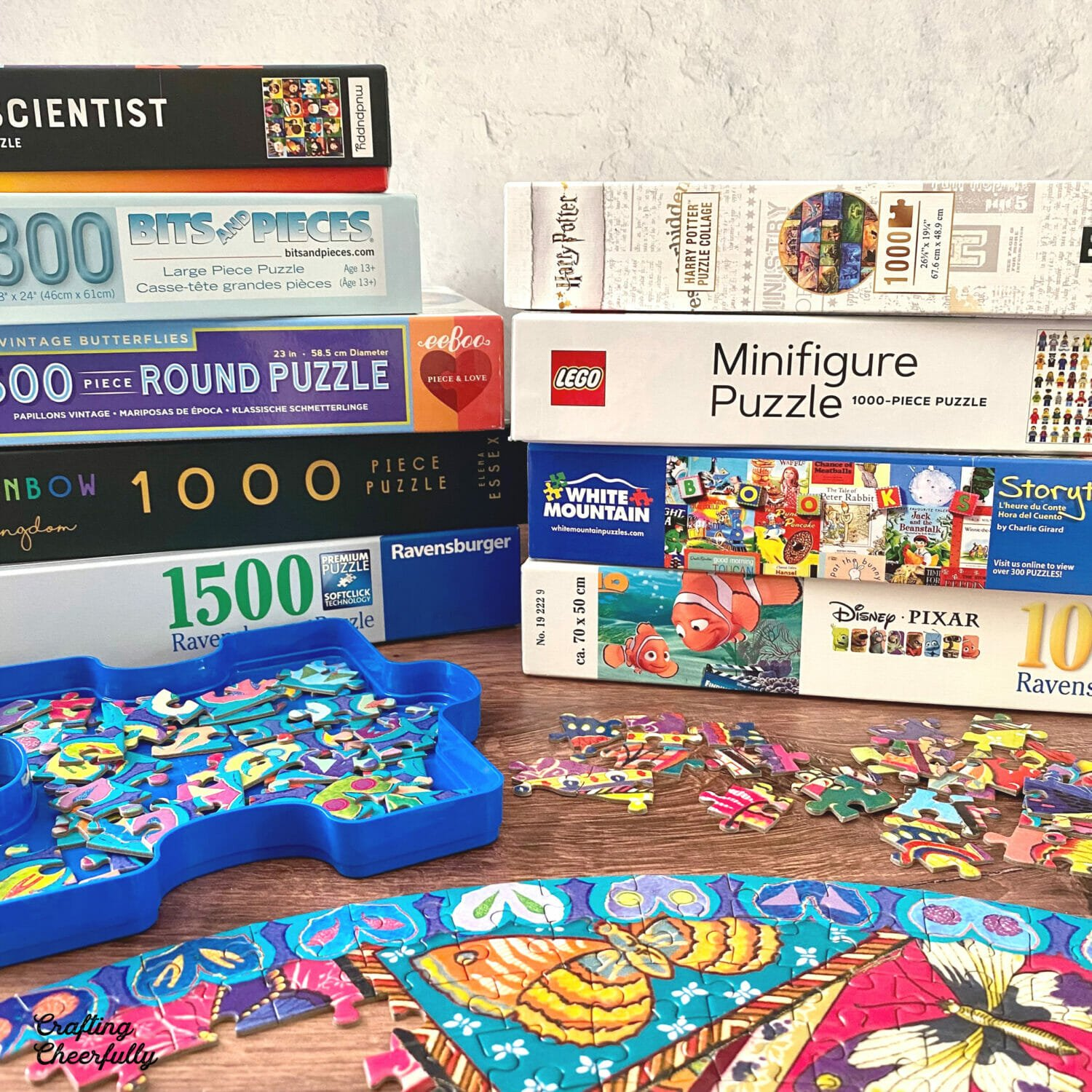 Family puzzles stacked up in a pile.