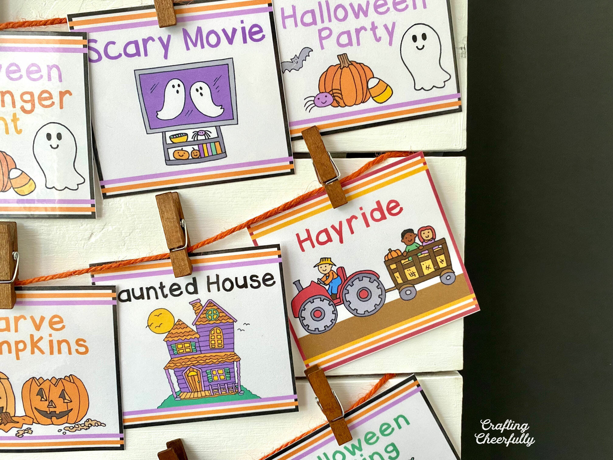 Halloween bucket list created with Halloween activity cards on a white board.