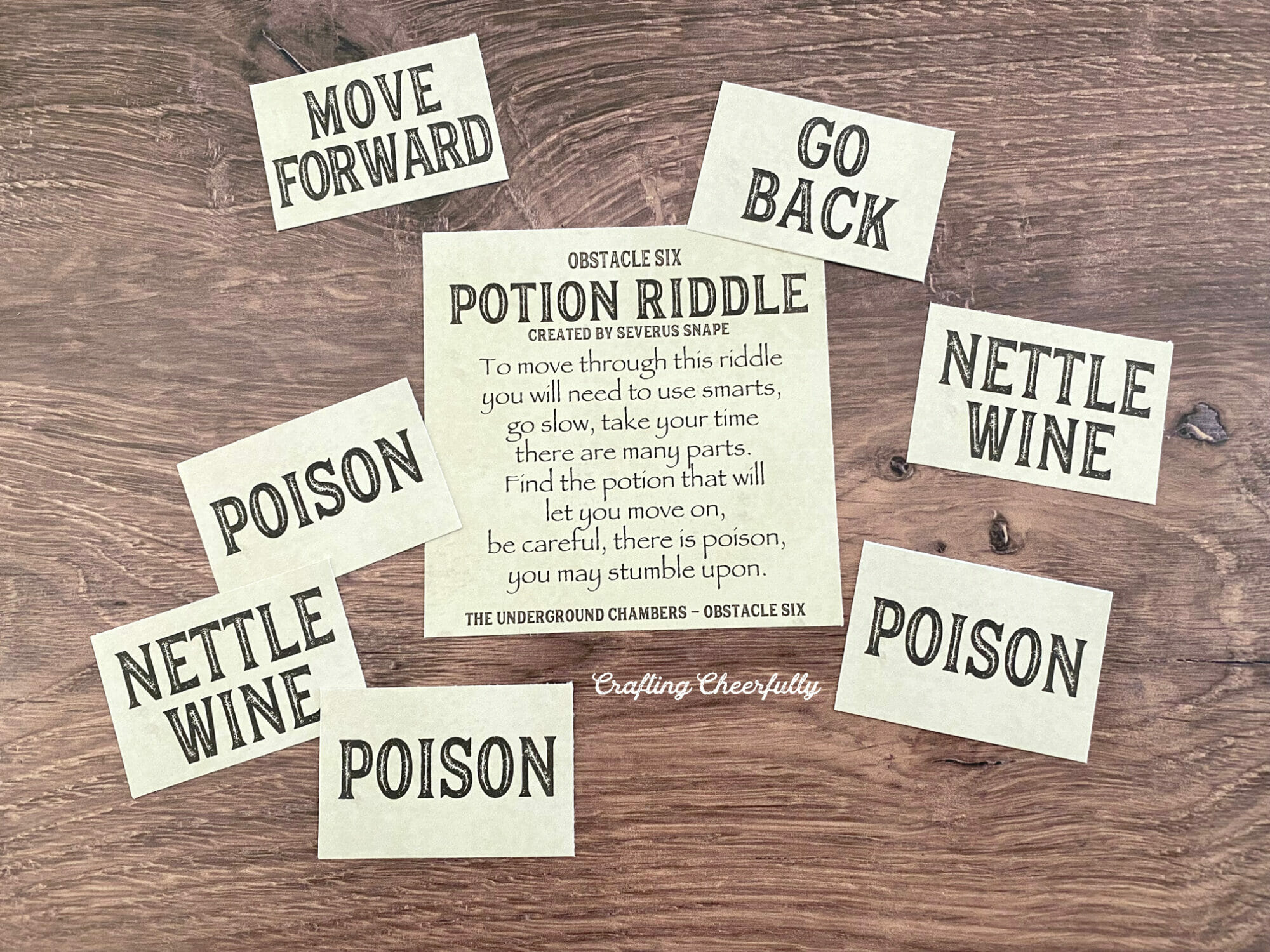 Obstacle six card lays on a table with smaller cards that read Poison, Nettle Wine and more.