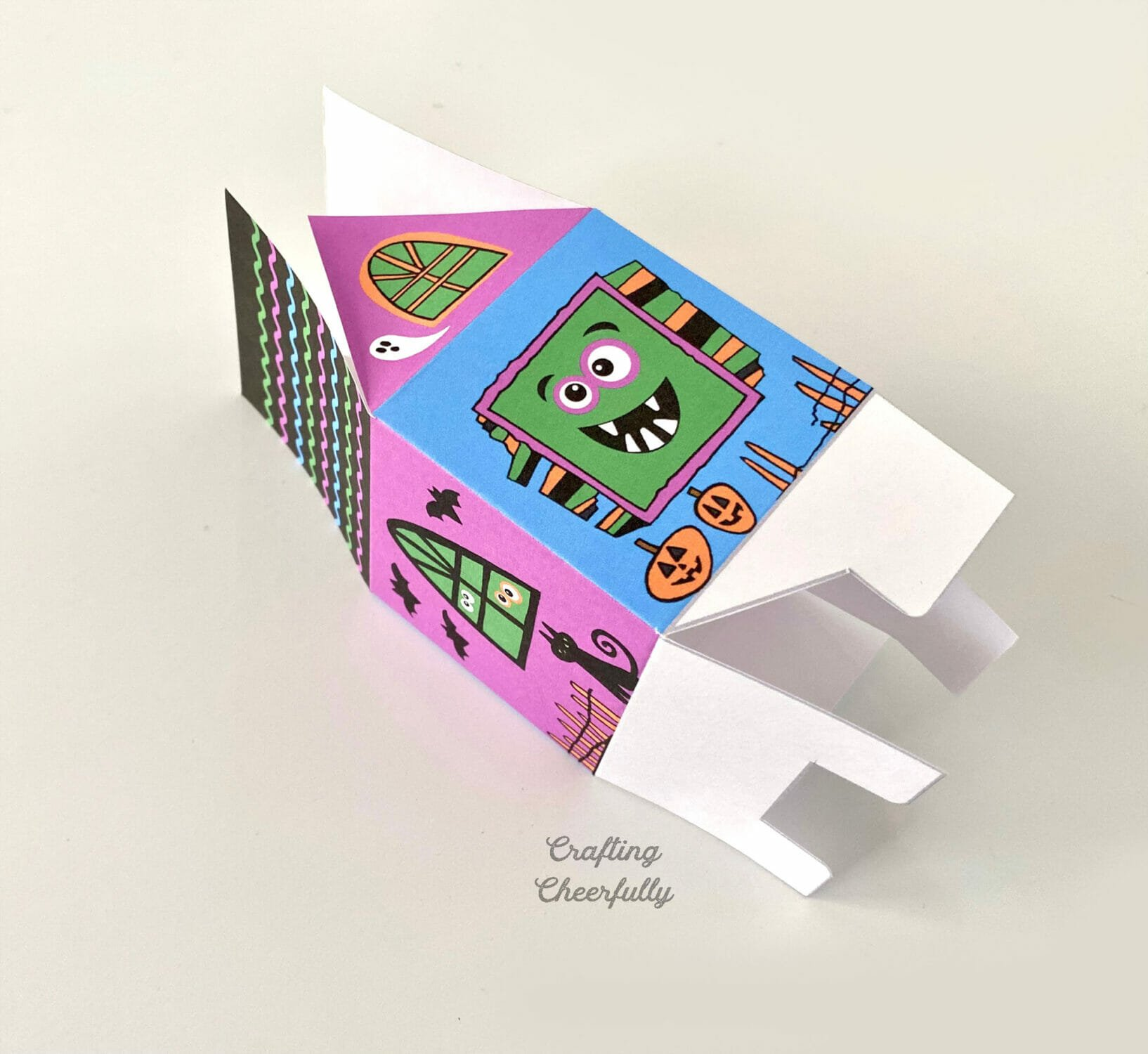 Printable monster box partially assembled lays on a white table top.