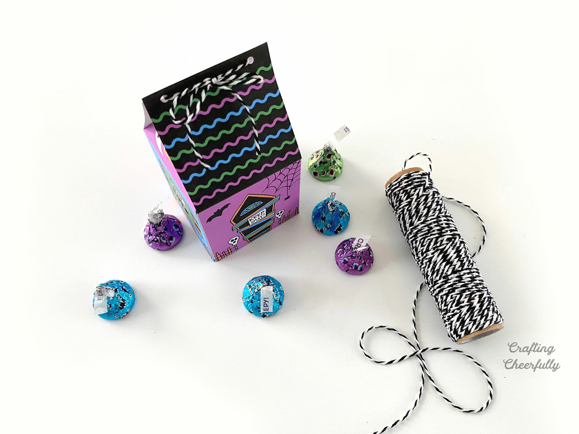 Haunted House Monster treat box sits next to a roll of Baker's twine and candy.