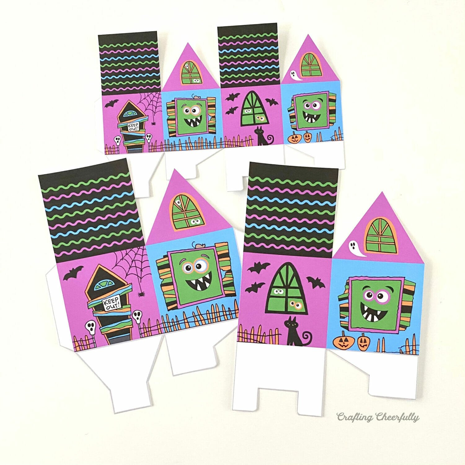 Cut out monster treat box printables on a white table.